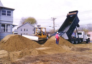Dump trucks were used to bring in clean fill after the soil was removed.