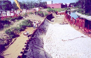 Workers dredge the banks of the Housatonic River in August 2002.