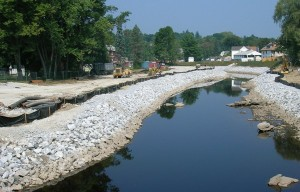 Crews use armor stone to complete Housatonic River shoreline stabilization.