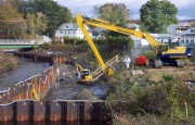 In many areas, work crews drove sheetpile into the Housatonic River to divert the water during work.